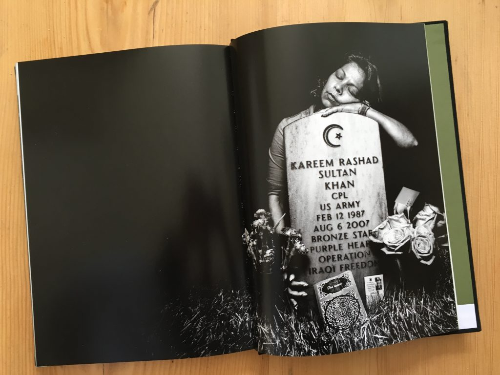 "The image of Kareem Rashad Sultan Khan's grave with his grieving mother from Platon's photo essay ""Service""."